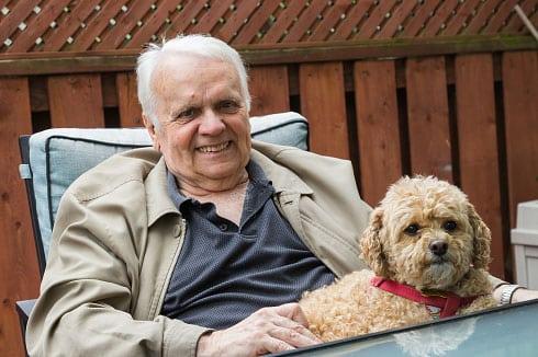 Elderly Man sitting down with his dog