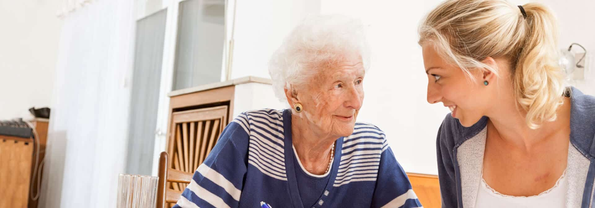 Caregiver and female client talking