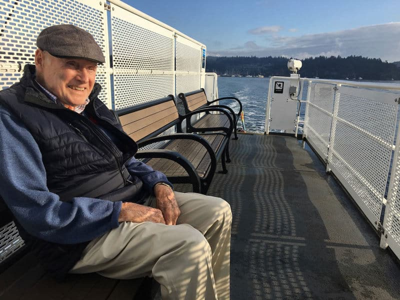 Man sitting on the deck of a ferry