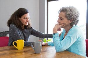 caregiver-comforting-senior-aging-parent